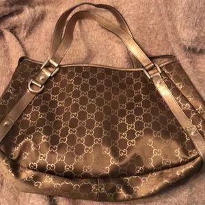 Authentic Gucci bronze satin purse
